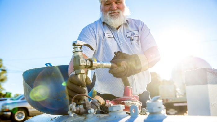 photo of working filling propane tank