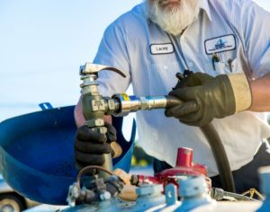 photo of worker filling propane tank